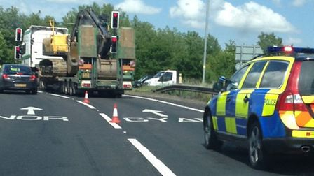 Broken down lorry blocking one of the lanes at Thickthorn roundabout on the A11.