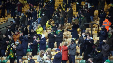 The Norwich fans celebrate their side's 1st goal during the Sky Bet Championship match at Carrow R