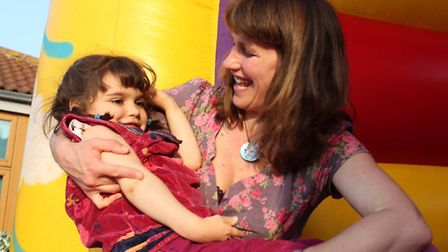 Six-year-old Woodfields pupil Lily Ocean Deller-Morris having fun on the bouncy castle with mum Jani