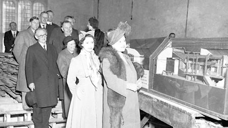 The Queen Mother and Princess Margaret visit the Guildhall during its restoration, in 1951.