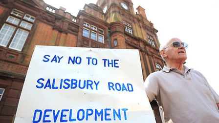 Residents holding a protest outside the town hall against the Saffron Housing development off Salisb