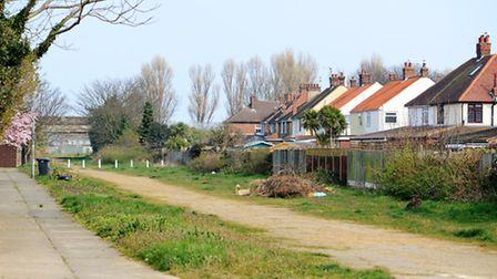 Plot of land earmarked for 12 new homes.Site is former railway track bed between Salisbury Road and