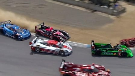 Alex Brundle being forced off track moments before hitting the cars in front at Laguna Seca.
