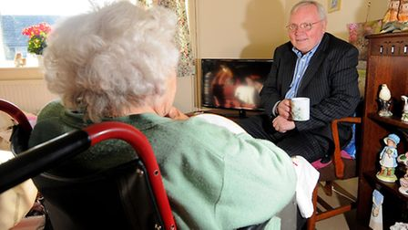 The Trunch pensioner at home with her North Norfolk District Council representative, Graham Jones, w
