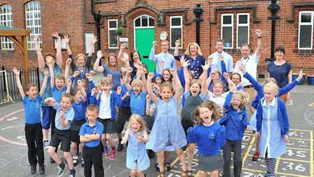 Pupils and staff celebrate an outstanding Ofsted report for Trowse Primary School.Photo by Simon Fin