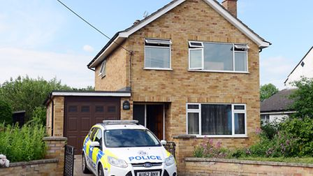 A police car on the drive of a house in Spinners Lane in Swaffham, which was the scene of a fire and