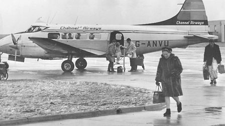 This photo shows a Channel Airways Dove landing passengers at the airport in 1968.