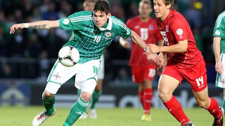 Kyle Lafferty in Northern Ireland action - the striker has left Palermo to join Norwich City.