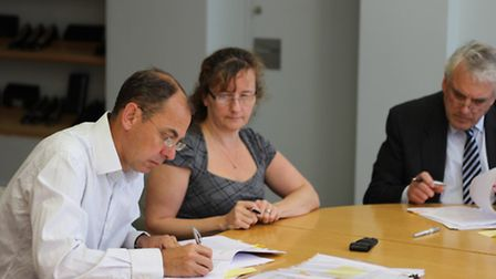 Simon Goodman, right, chairman of The Florida Group, with director Pamela Clarke, middle, and managi