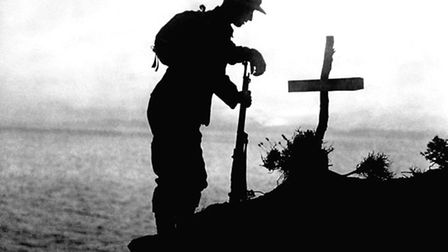 A British soldier paying his respects at the grave of a colleague near Cape Helles, where the Gallip