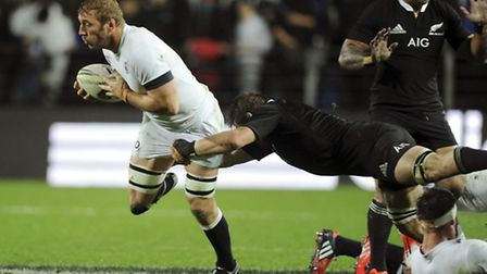 England's Chris Robshaw tackled by New Zealand's Richie McCaw in the third International Rugby Test