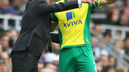 Norwich boss Neil Adams and defender Russell Martin will be key men in City's Championship promotion