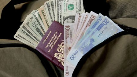 Passport and foreign money. Picture credit: PA Photo/Handout.