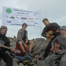 Playing at the summit of Scafell Pike, from left, are Bradley Carr, Frazer Stanford, Zach Stanford a