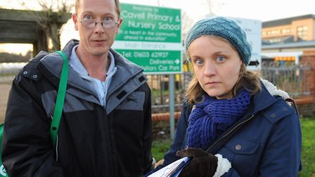 Parents Mark Sayer, and Rachel Ward, with the petition parents have signed against the plans to turn