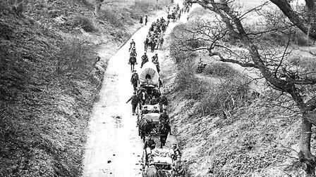 Transport of the 8th Norfolk Regiment on the march during manoeuvres, Hollesley, 1915