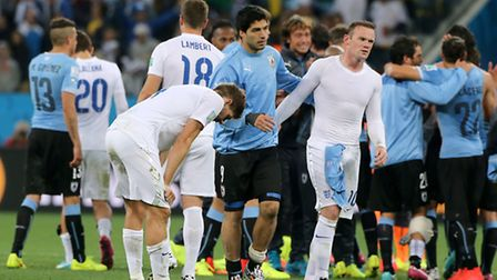 Uruguay's Luis Suarez with England's Wayne Rooney and Steven Gerrard after the final whistle. Photo: