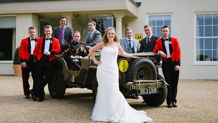 Bride and bridegroom Emma and L/Cpl Steven Nichols with some of the wedding party in front of the 19