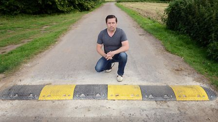 Adam Guerin with the speed bumps on Neatherd Moor in Dereham, which he says is making access to his