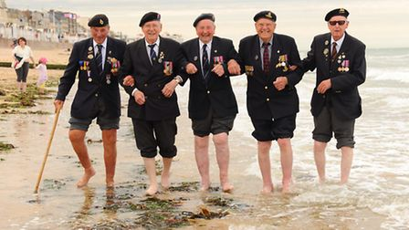 The Norfolk veterans take time out from their official pilgrimage in Normandy to show their joy at b