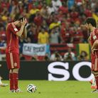 Spain's Diego Costa, left, and David Silva prepare to kick off after Chile scored their second goal.