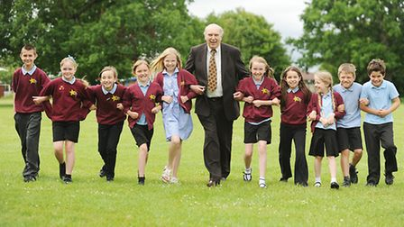 Olympian Mike Tagg with pupils at Toftwood Junior School. Picture: Ian Burt
