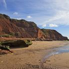 The red cliffs and silver seas at Orcombe Point