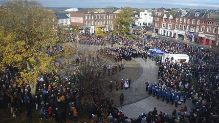 Exmouth residents fill The Strand to mark Remembrance Sunday. Picture: Jason Sedgemore