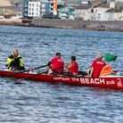 An Exmouth Rowing Club crew being oput through their paces off shore. Picture LES NORCLIFFE