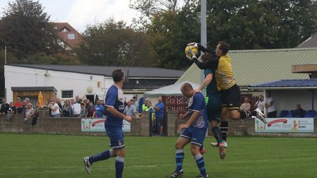 Exmouth Town goalkeeper Robbie Powell in the thick of the action during the FA Cup home defeat to Me