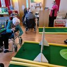 Residents taking part in indoor golf day. Picture: Pinewood Care Home