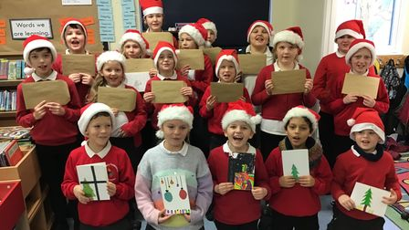 Children in the samphire class at Brancaster Primary School with their Christmas cards.