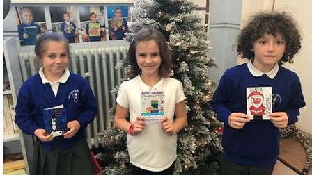 Pupils in year fourat Angel Road Junior School with their Christmas cards.