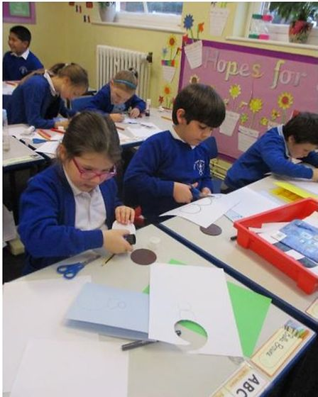 Pupils in year three at Angel Road Junior School making Christmas cards.