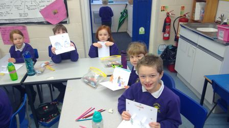 Pupils in years one and two at Thompson Primary School, near Thetford, with their cards.
