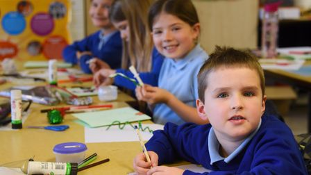 Year 4 children at St Mary's Junior School at Long Stratton, working on their Christmas cards for th