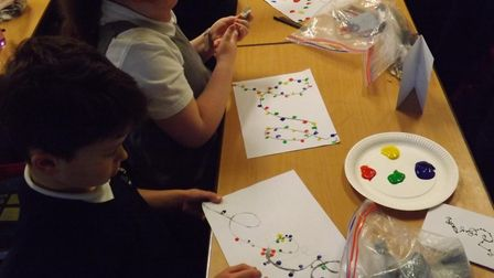 Homefield Primary School pupils making Christmas cards.