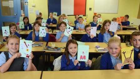 A Year 4 class at St Mary's Junior School at Long Stratton, with their Christmas cards for the proje