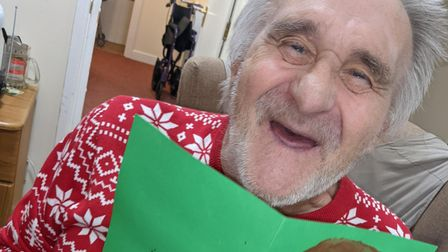 Thomas Trestain, a resident at Laurel Lodge with his Christmas Card from Mile Cross Primary School.