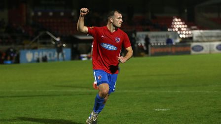 Mitch Brundle of Dagenham and Redbridge scores the third goal for his team and celebrates during Dag