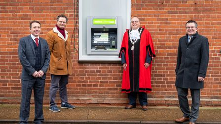 Bungay town clerk Jeremy Burton, Waveney MP Peter Aldous, mayor Bob Prior and Ian Vernon, LINK's head of commercial initiatives, unveil the new ATM at the town council offices on Broad Street.