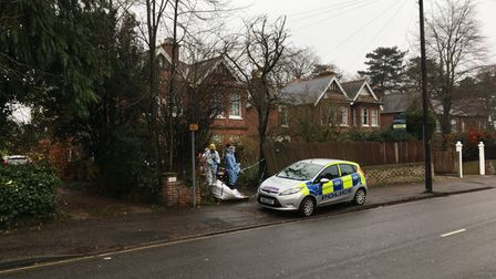Forensics officers investigating a fatal house fire on Unthank Road in Norwich.