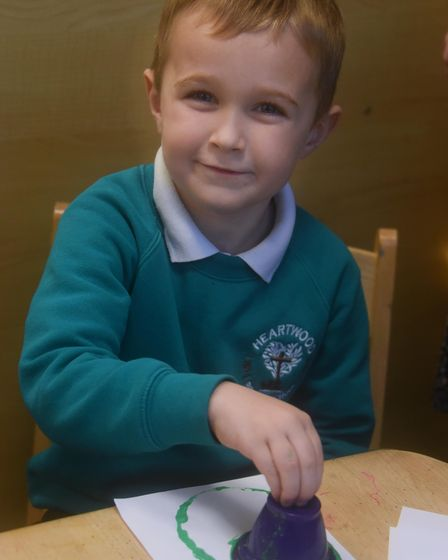 Mason, four, at Heartwood Primary School at Swaffham working on his Christmas cards for the project