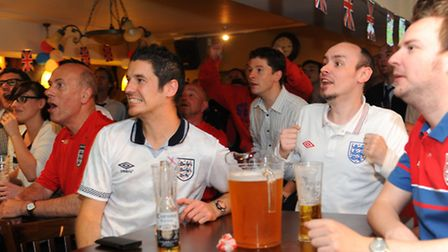 England fans watch the England against France Euro football match at the Woolpack in Norwich. Pictur