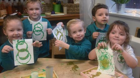 Children at Heartwood Primary School at Swaffham working on their Christmas cards for the project to