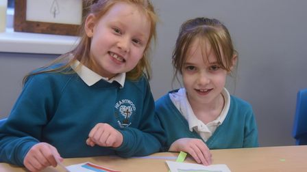 Year 2 children Kira, left, seven, and Denise, six, at Heartwood Primary School at Swaffham working