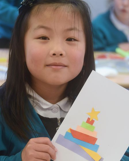 Nicole, six, at Heartwood Primary School at Swaffham with her Christmas cards for the project to sha