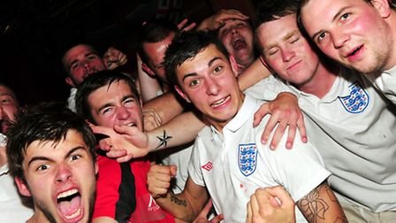 England V Slovenia. Fans celebrate the England victory at Peggottys pub in Yarmouth. Photo: Nick But