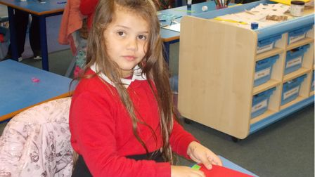 St George's Primary School in Great Yarmouth pupil Kelsyputting the finishing touches to her card.