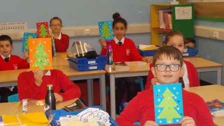 Members of the Lynx class at St George's Primary School in Great Yarmouth show off their cards.